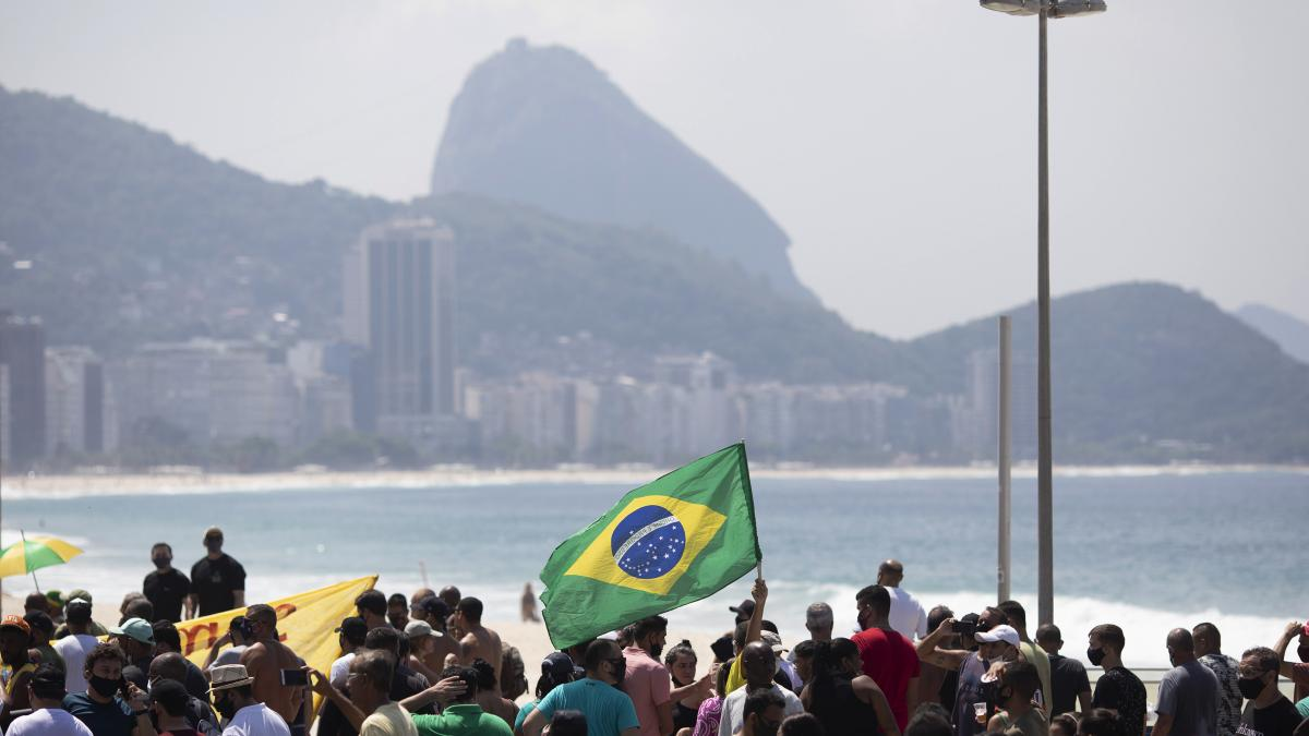 Supporters of Brazilian President Jair Bolsonaro protest the start of a 10-day period of increased restrictions, which includes Holy Week, to help curb the spread of COVID-19, on Copacabana beach in Rio de Janeiro, Brazil, last month.