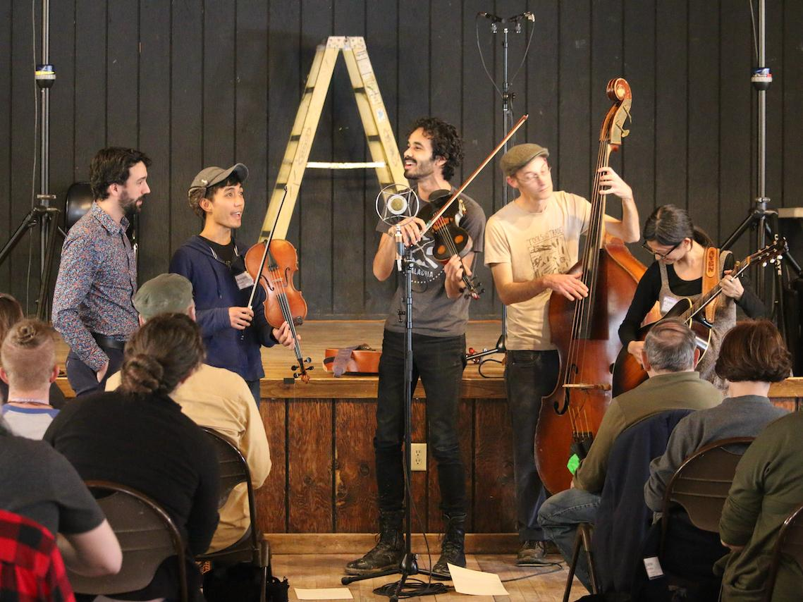 Jake Blount leads a musical performance in his workshop during the Youth Traditional Song Weekend.