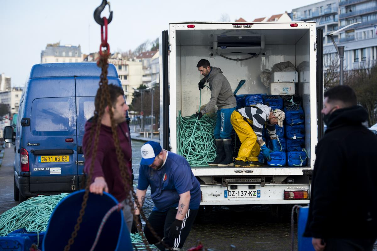 """Crew from the fishing boat L'Ophelea unload equipment in Boulogne-sur-Mer. Brexit supporters have equated fishing rights with British sovereignty and claimed Europeans were """"stealing"""" their fish."""