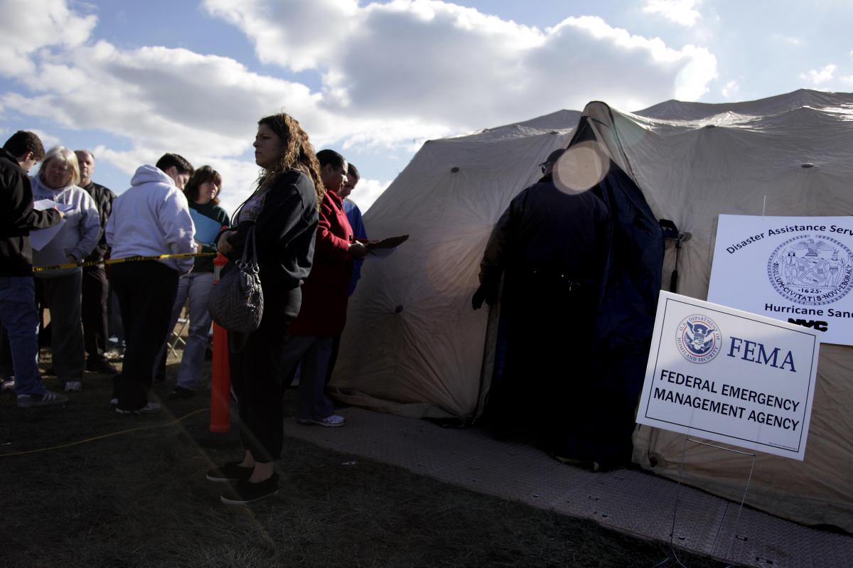 Residents affected by Superstorm Sandy wait outside a FEMA tent in 2012. FEMA has made disaster legal services available after past disasters, including Sandy and hurricanes Harvey, Irma and Maria.