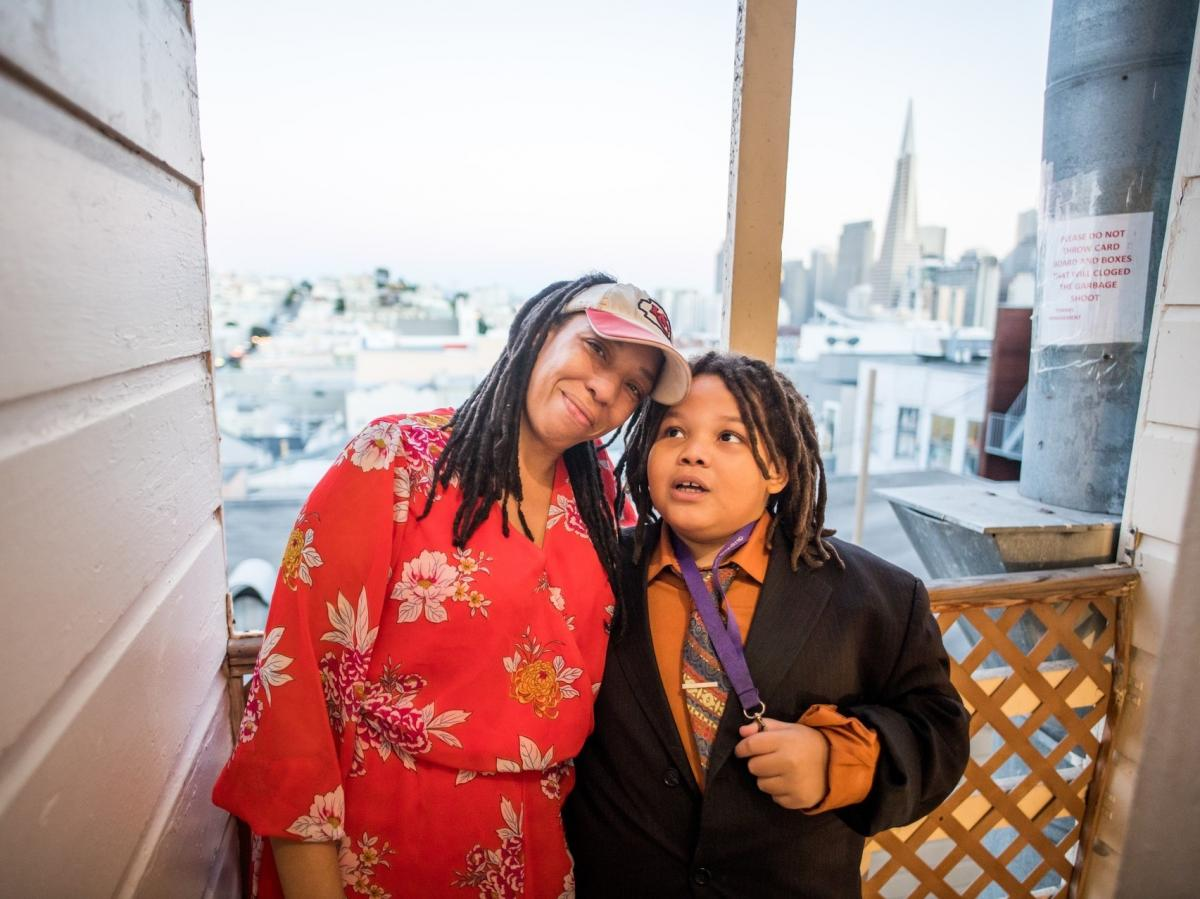 Jessica Ellis and her son, King, pose for a portrait on the back stairs of their apartment building on Nov. 15.