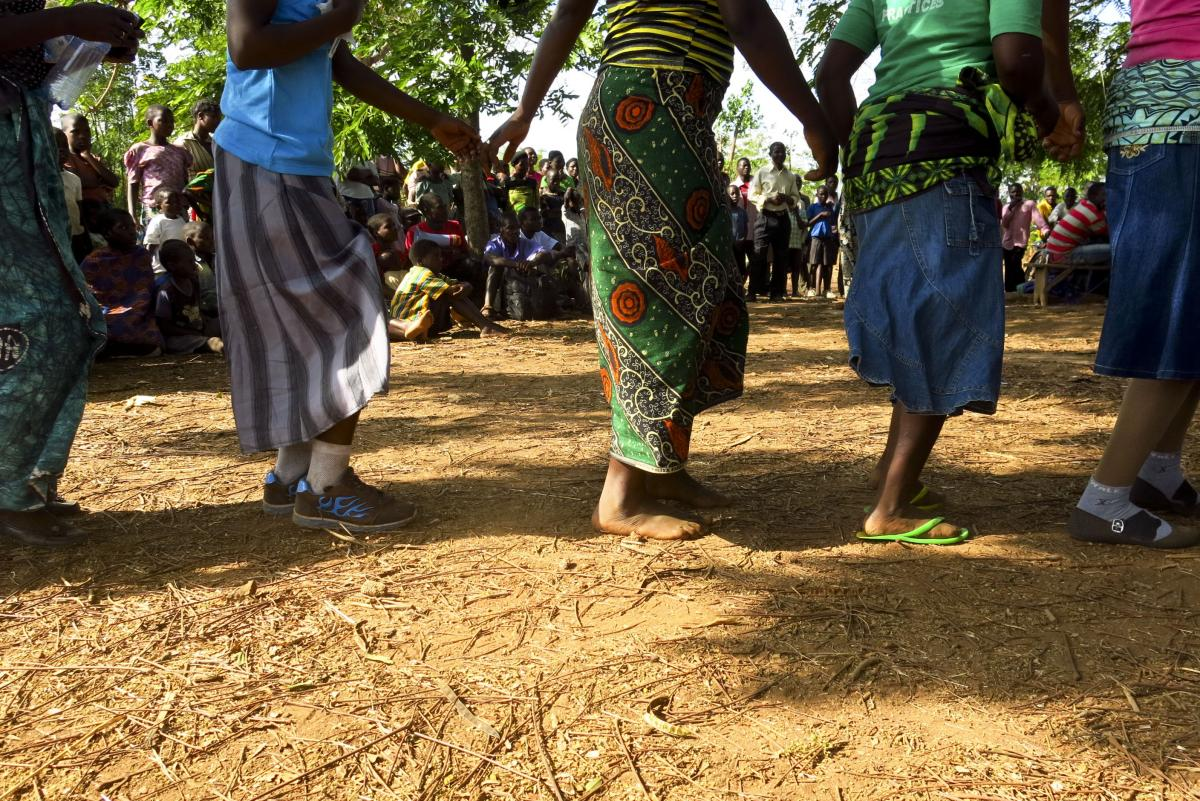 "The play is staged in a celebratory atmosphere, with drumming, dancing and singing. The lyrics of one song include the line, ""Force your daughters to go to school, not to get married."""