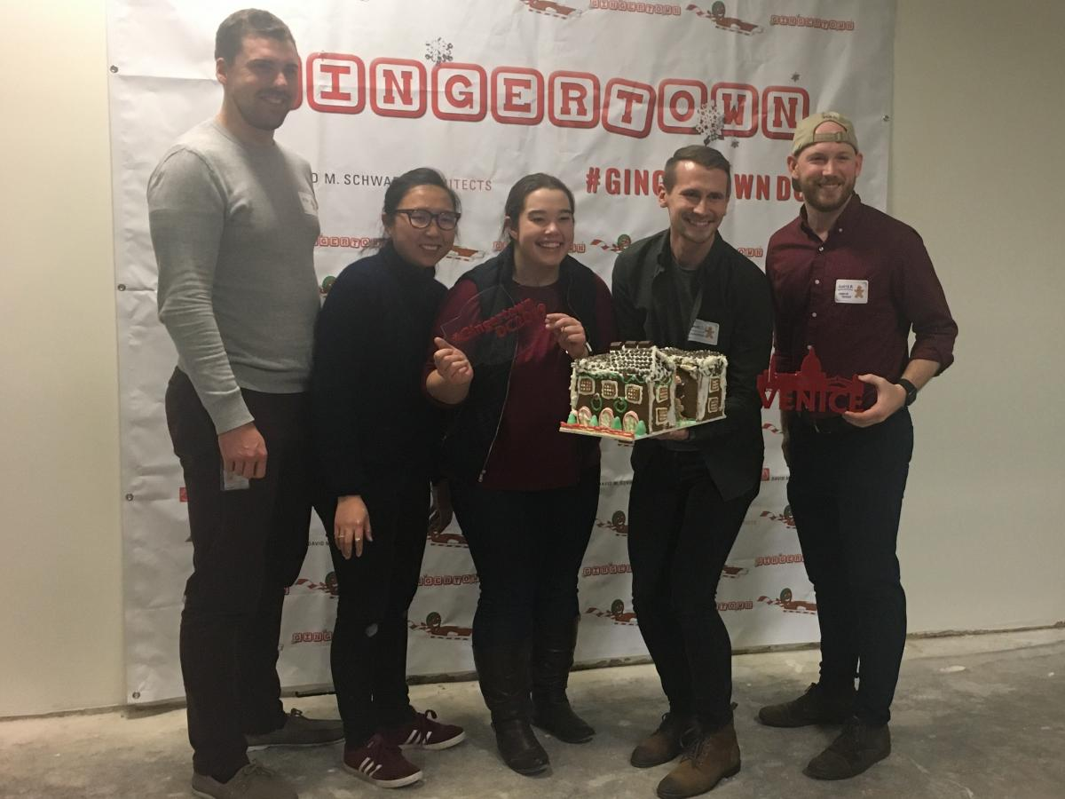 CannonDesign presents their finished Venetian gingerbread building before carrying it down to the lobby. From left to right: Max Hurley, Cheng Gao, Christen Fairley, Daniel Olberding and Hunter Young.