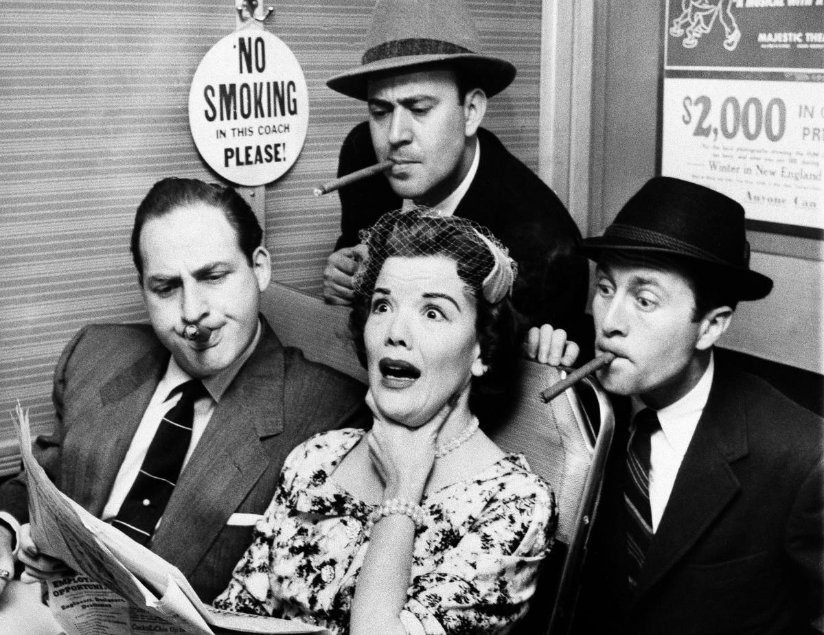 Reiner (top center), Sid Caesar (left), and Howard Morris bother railroad commuter Nanette Fabray on an episode of the sketch comedy show Caesar's Hour in 1955.