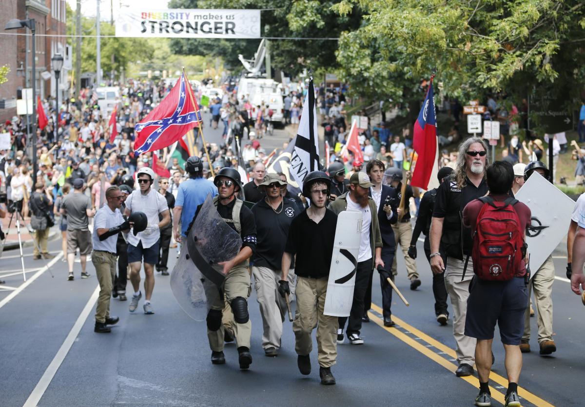 White nationalist demonstrators walk through Charlottesville on Aug. 12, 2017.