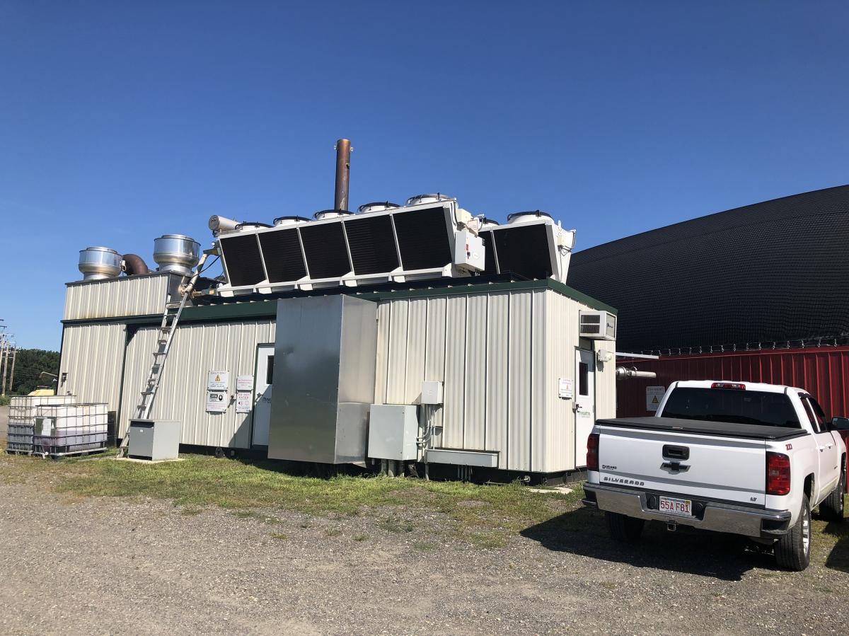 A large motor (housed inside here) runs on the methane gas captured in the digester. This motor powers a generator, which creates electricity — enough to power about 1,500 homes.