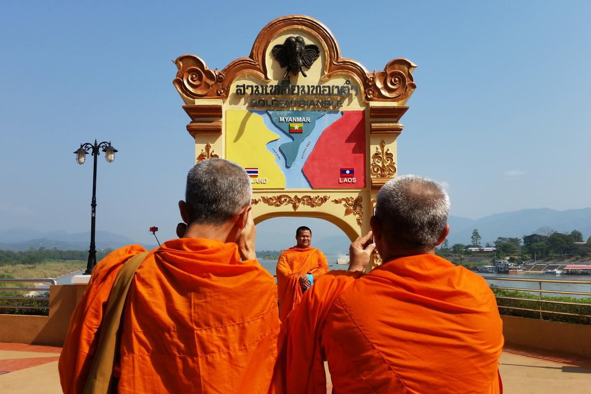 Buddhist monks snap photos on the Mekong in the town of Sob Ruak, northern Thailand, near the borders with Myanmar and Laos.