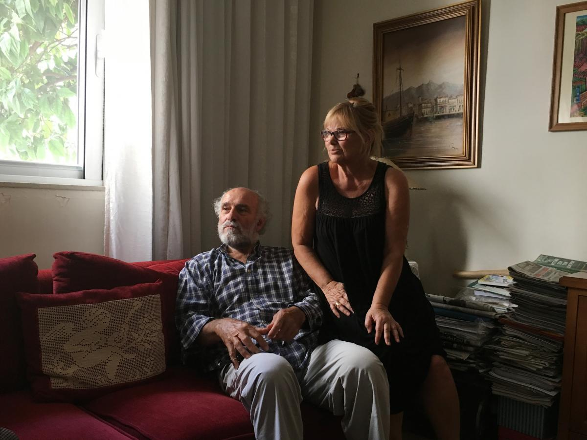 """Giorgos Nouchoutidis, shown at home with wife Maria, worked at the port of Piraeus for decades before retiring in 2010. """"It's a huge mistake for our government — and for the European Union — to have given up this port to the Chinese,"""" he says."""