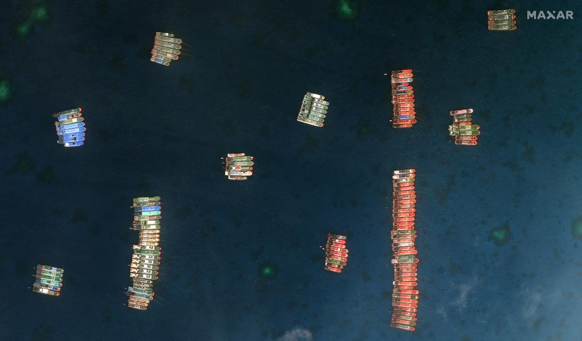 """Closer view of Whitsun Reef and fishing vessels that appear lashed together near the reef on March 23. At the time they were observed, Asian maritime analyst Jay Batongbacal says they appear to be stationary, """"and really not conducting fishing operations."""