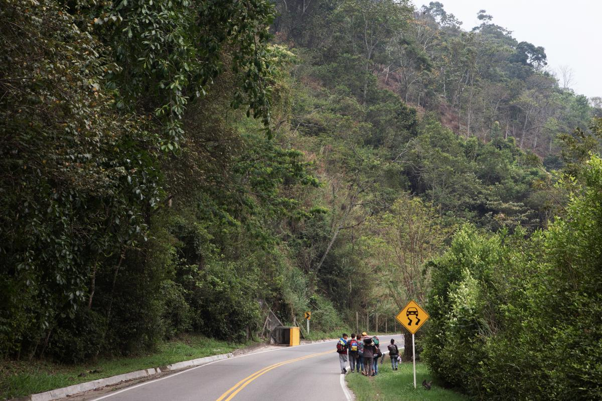 This family walks on the road between Cúcuta and Pamplona, Colombia. Members of the family estimate they will have 20 days of walking left before they reach Peru. The youngest children range from 1 to 3 years old.