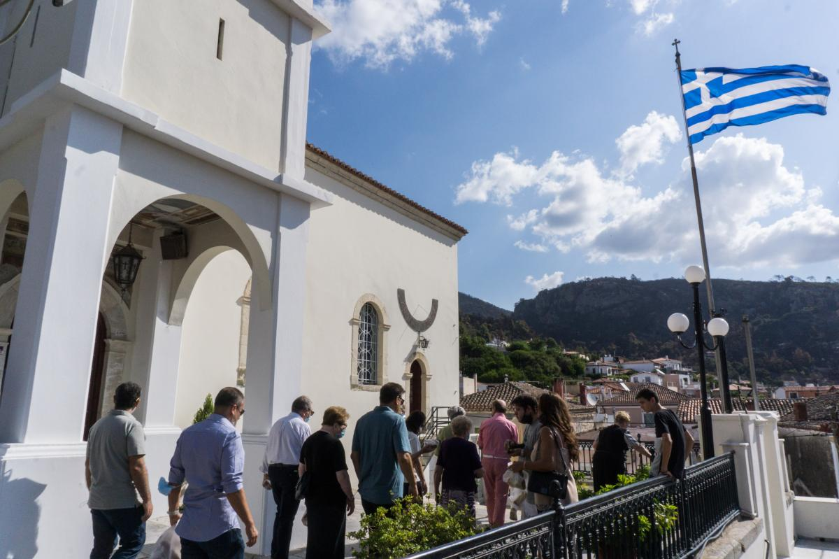 Residents of the village of Limni in northern Evia mourned the loss of their forest during a service at the church of Panagia Limnia.