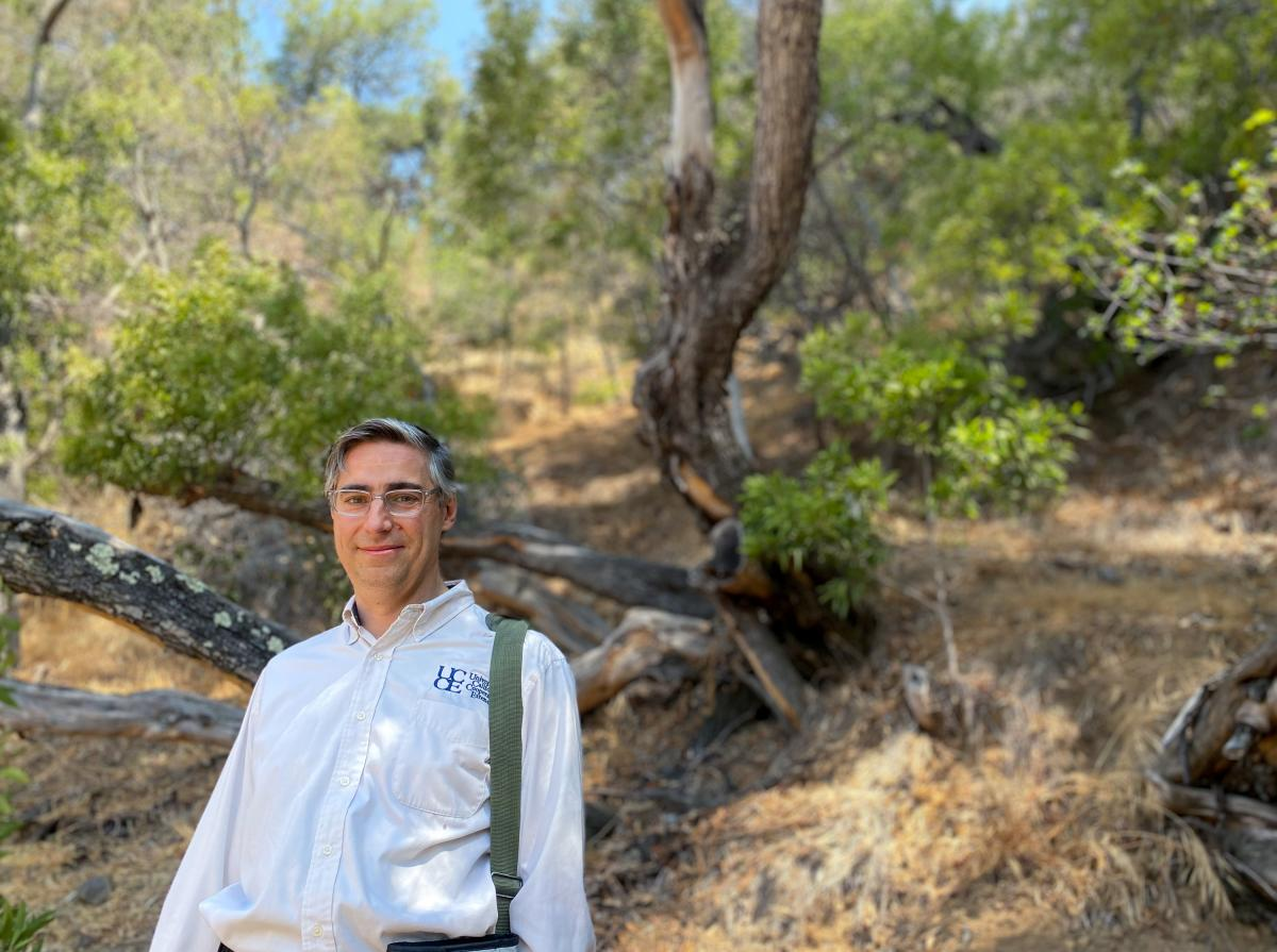 Lacan stands near a dying acacia tree on a hill in Oakland, Calif. Lacan is horticulture adviser for the University of California Cooperative Extension, and part of his job involves advising utilities such as Pacific Gas & Electric how to spot sick trees