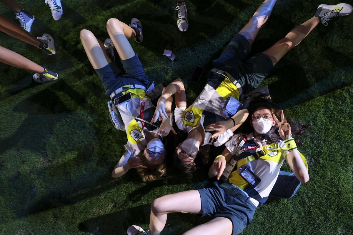 Athletes of Australia pose during the closing ceremony in the Olympic Stadium at the Summer Olympics in Tokyo.