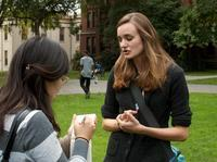"""Brown University senior Emily Kirkland (right) speaks with a student newspaper reporter. Kirkland, who studies environmental science, has been leading a divestment campaign at Brown and says she has seen how powerful such protests can be. """"Our administrat"""