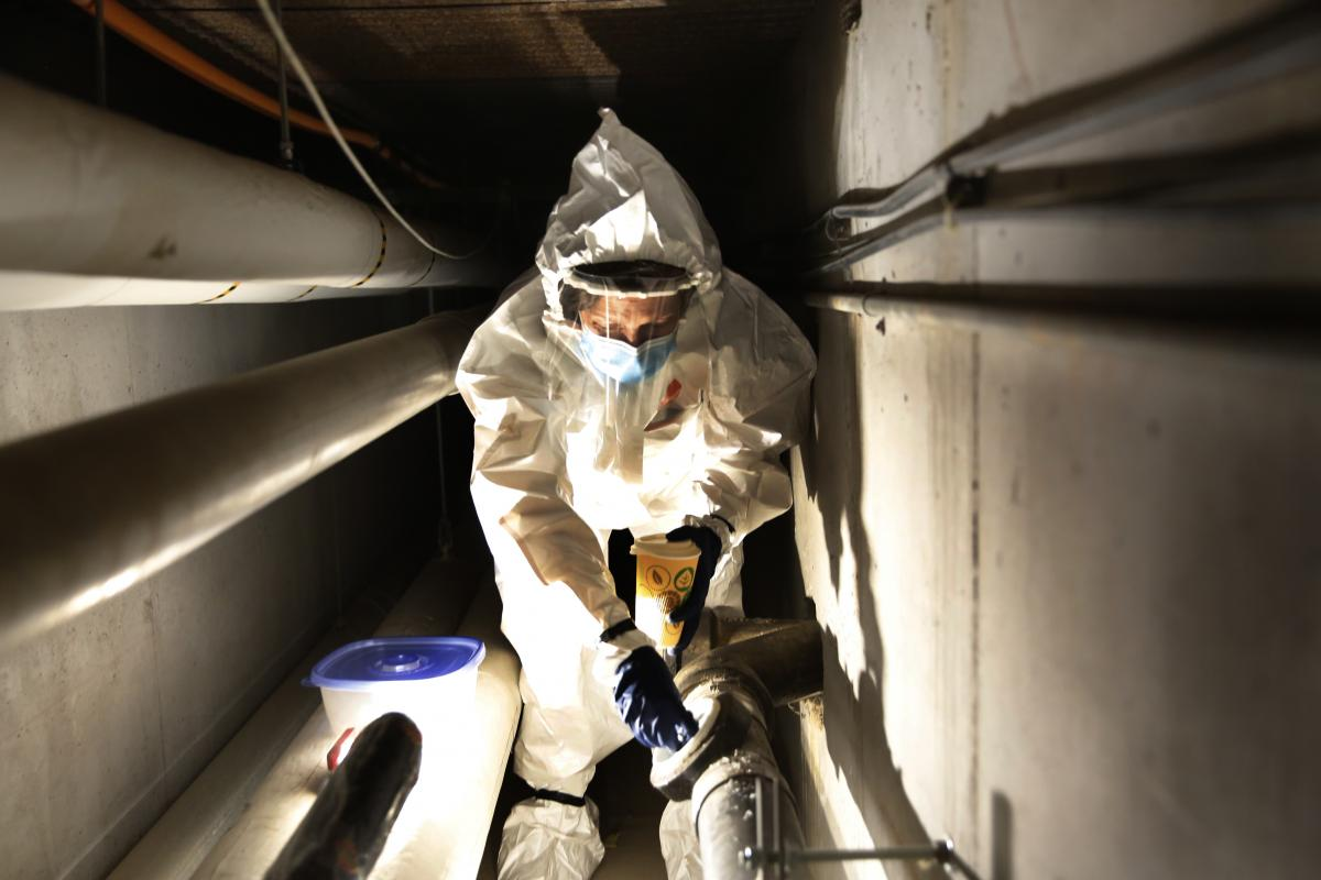 Colorado College hasn't yet invested in a 24-hour pump like CSU has. Andrea Bruder has to fetch the samples herself by crawling into dark, damp tunnels and waiting for a flush.