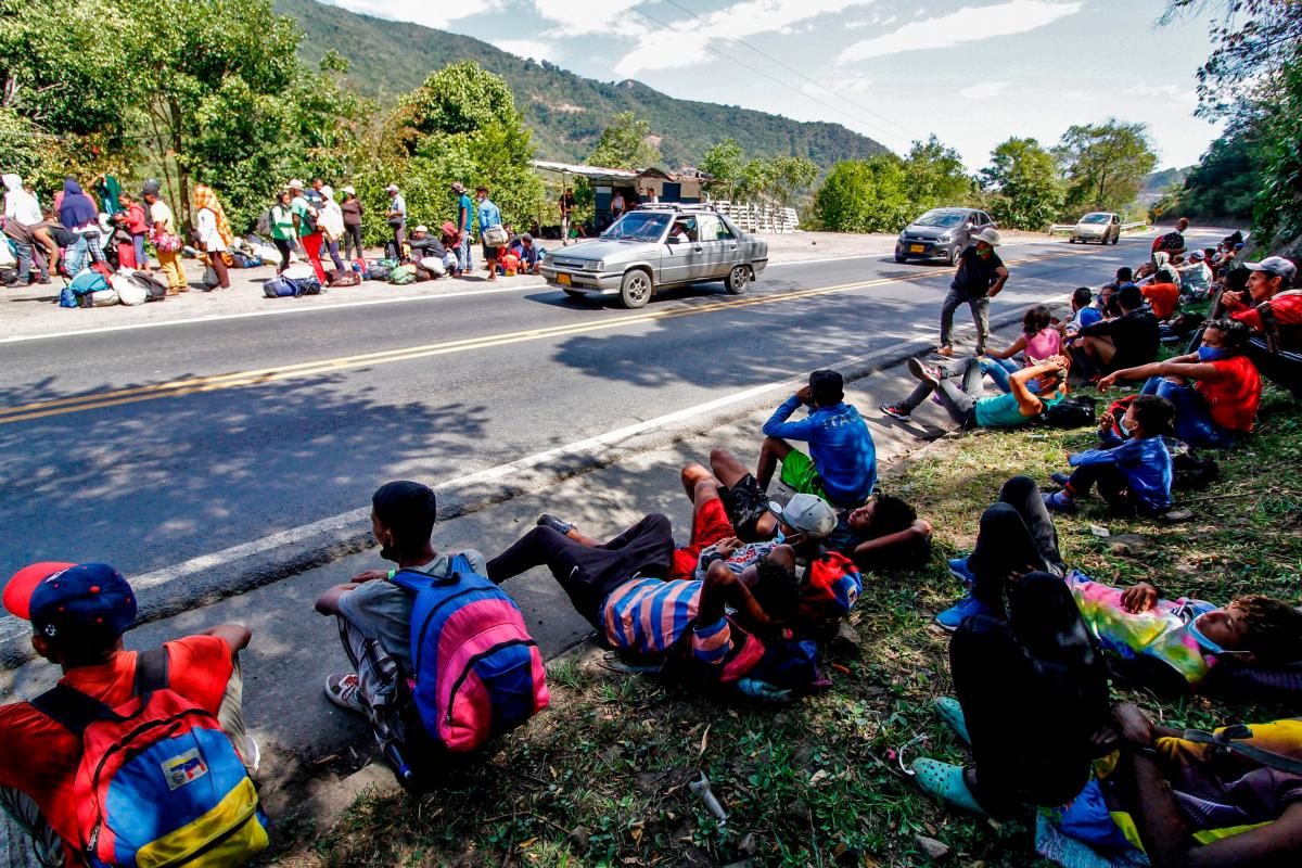Venezuelan migrants rest as they wait to receive food and medicines from members of the Red Cross on a highway in Cucuta, Colombia, on the border with Venezuela last month.