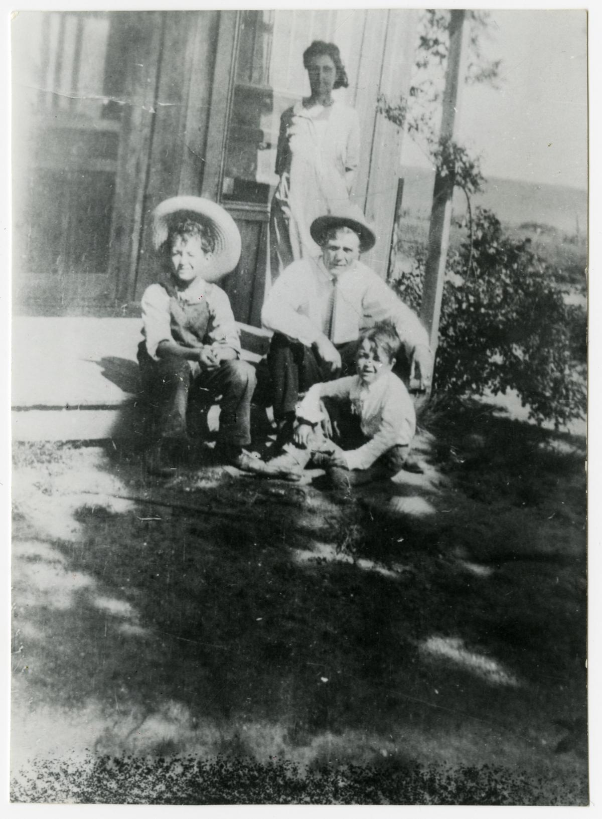 Woody Guthrie with his parents, Nora Belle and Charley, and brother George, at their home in Okemah, Okla., in 1926.