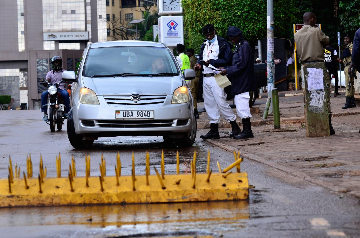 A car stops in front of a roadblock in Kampala, Uganda. The government has imposed restrictions on transportation as part of its effort to halt the spread of the coronavirus.