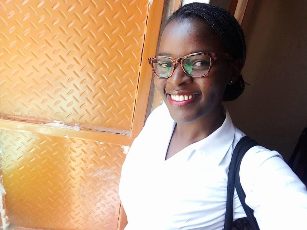 Maria Nakalanda, a nurse, often catches a ride on a crowded ambulance to get to work.