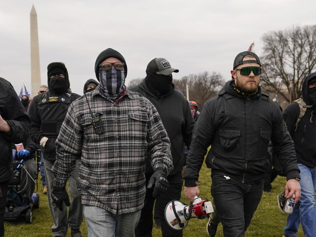 Joe Biggs (left) and Ethan Nordean (right) walk toward the U.S. Capitol on Jan. 6. Members of the Proud Boys, including Biggs and Nordean, have become central targets of the Justice Department's sprawling investigation into the Capitol riot.