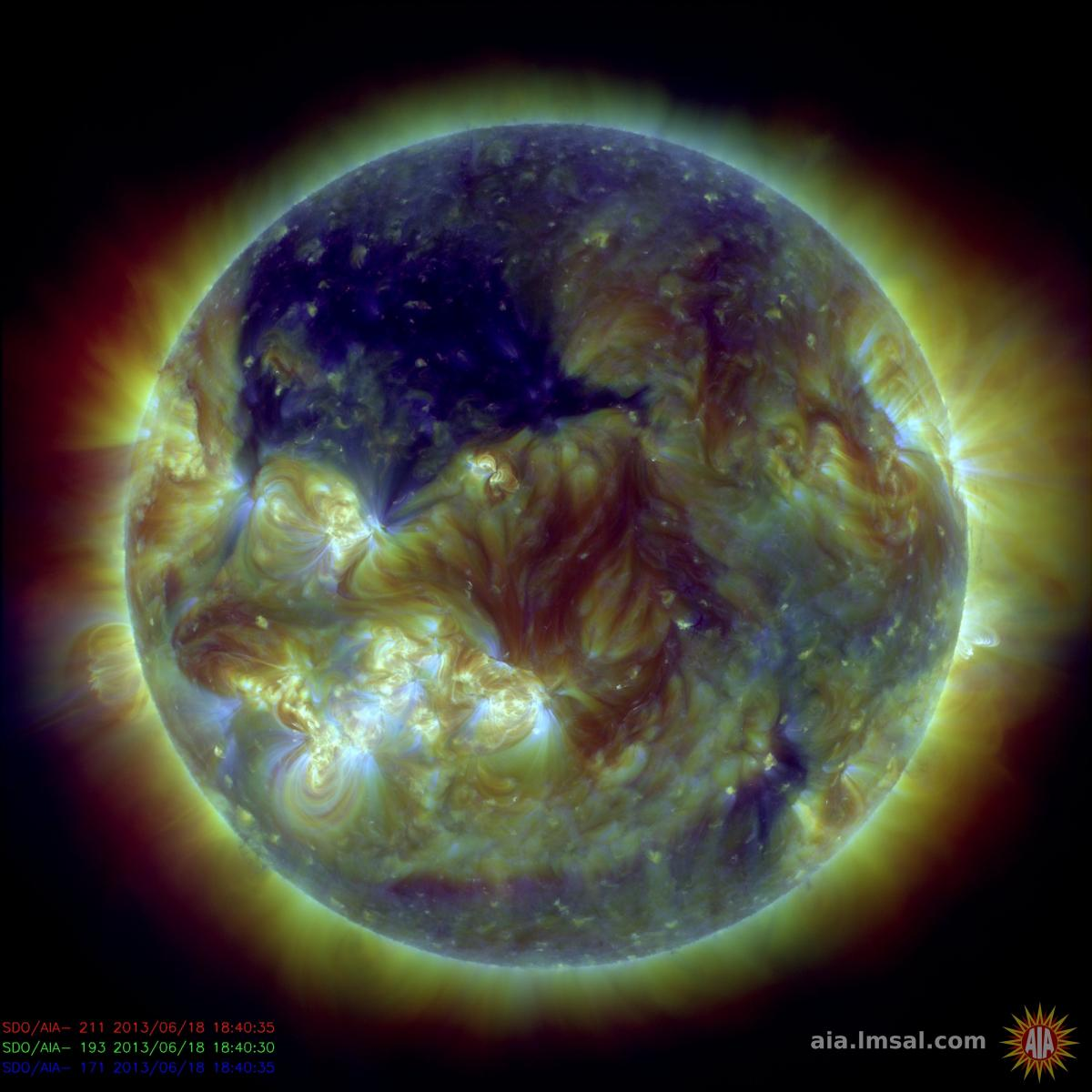 NASA's Solar Dynamics Observatory captured this picture of the sun on June 18. The dark blue area in the upper left quadrant of the sun is a huge coronal hole more than 400,000 miles across. Coronal holes are areas of the sun's outermost atmospheric layer