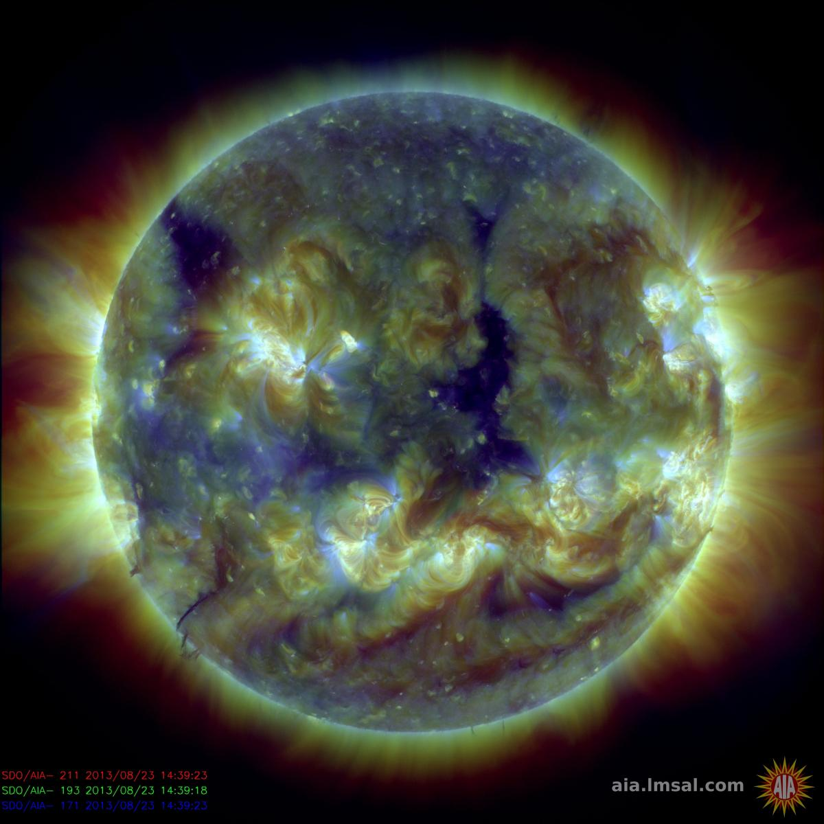 This image combines three images with different, but very similar, temperatures. The colors are assigned differently than in the single images. Each highlights a different part of the corona.