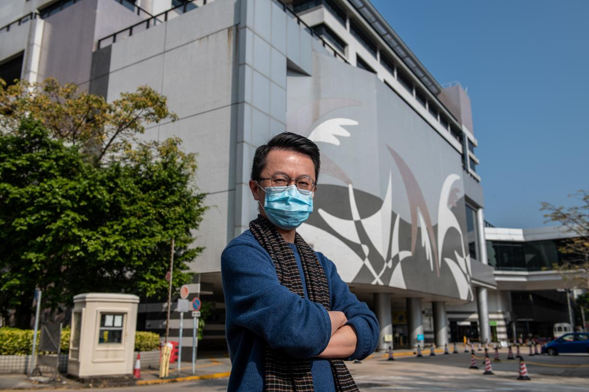 Dr. Alfred Wong stands in front of Tuen Mun Hospital in Hong Kong. He says the new coronavirus outbreak has placed incredible stress on health care workers.