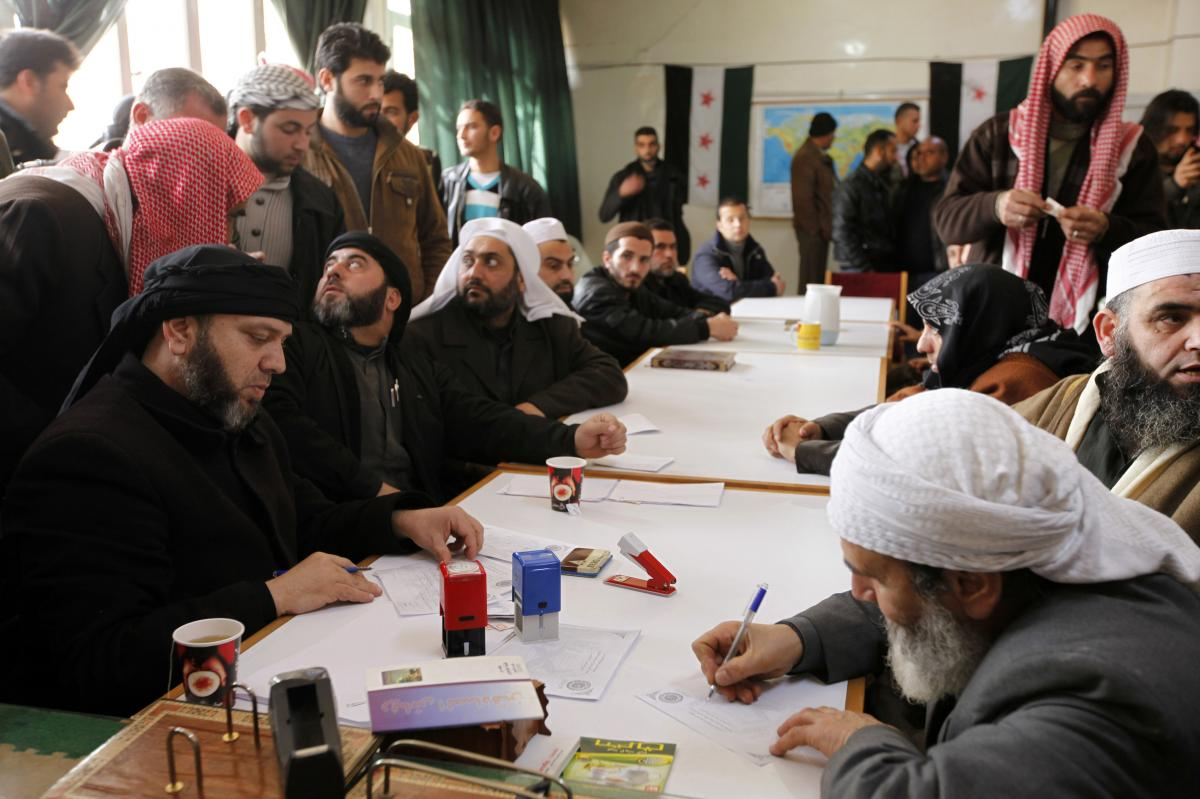 "An Islamist rebel group in Aleppo called ""the Authority for the Promotion of Virtue and Supporting the Oppressed"" reviews applications for aid on Feb. 25. In addition to handing out aid, the Islamist group says it is carrying out civilian administration i"