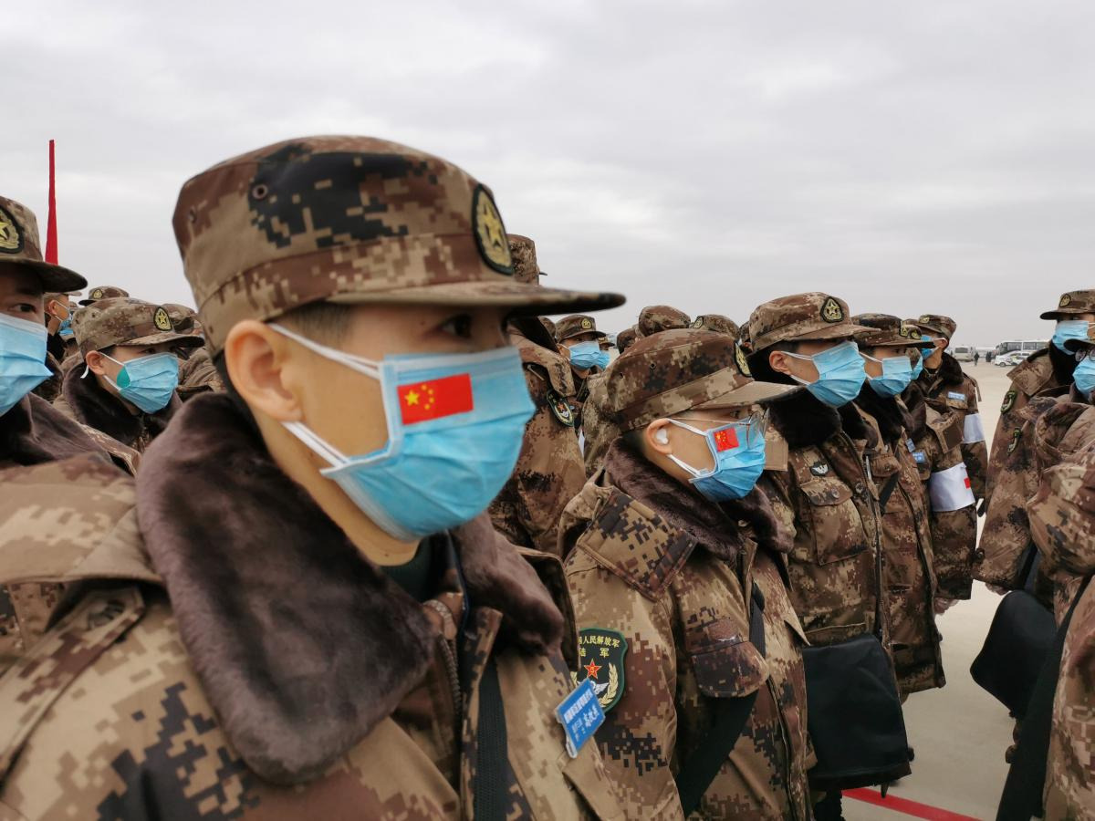Military medics arrive at Tianhe International Airport in Wuhan, central China's Hubei province, on Thursday. On orders of the Central Military Commission, 11 transport aircraft of the People's Liberation Army Air Force sent medics and supplies.