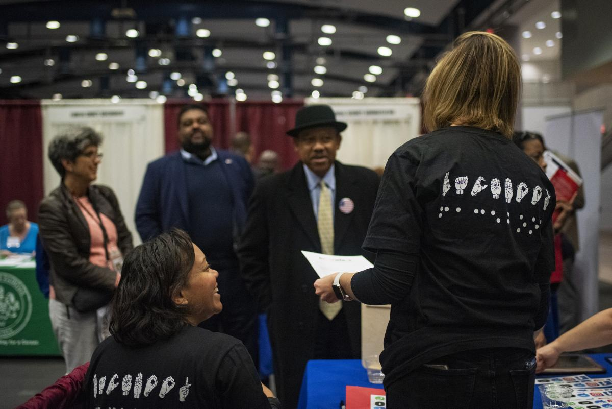 Job candidates with disabilities attend Careers & the Disabled magazine's career expo hosted by Equal Opportunity Publications in Washington, D.C.