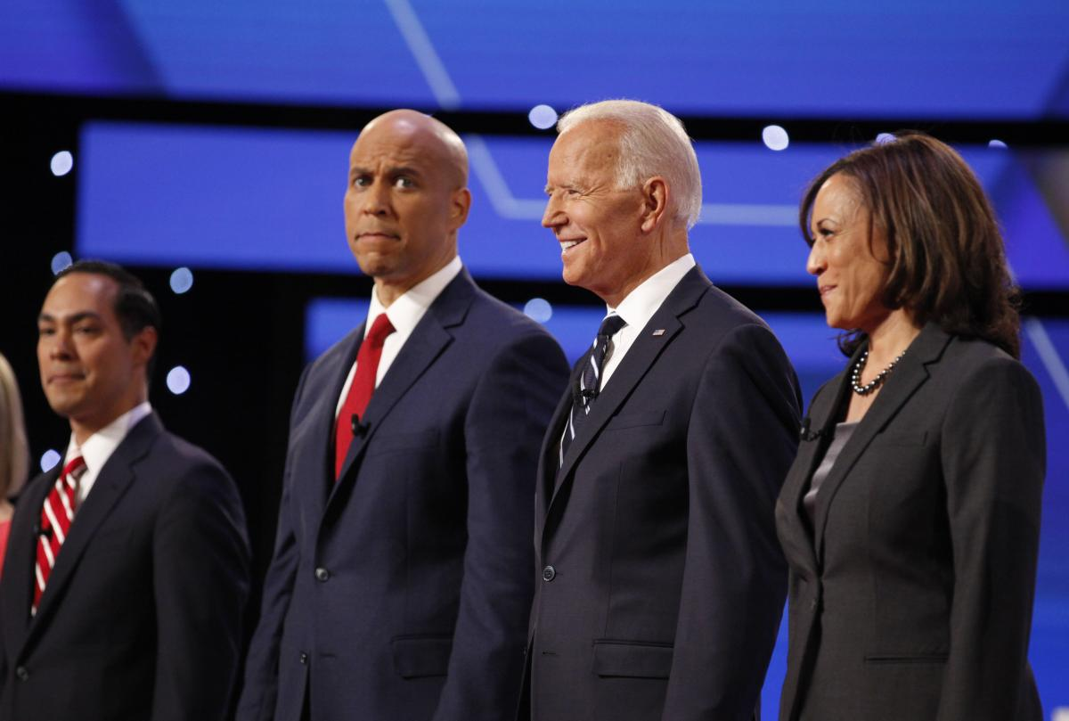 Sen. Cory Booker (second from left), former Vice President Joe Biden and Sen. Kamala Harris stand onstage on the second night of the second Democratic presidential debates, held in July.