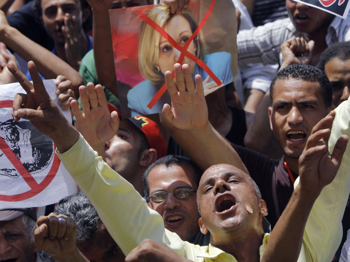 Egyptian protesters shout anti-Muslim Brotherhood slogans as they hold posters depicting U.S. Ambassador to Egypt Anne Patterson and President Mohammed Morsi in Tahrir Square, focal point of the Egyptian uprising, in Cairo, in June 2013.