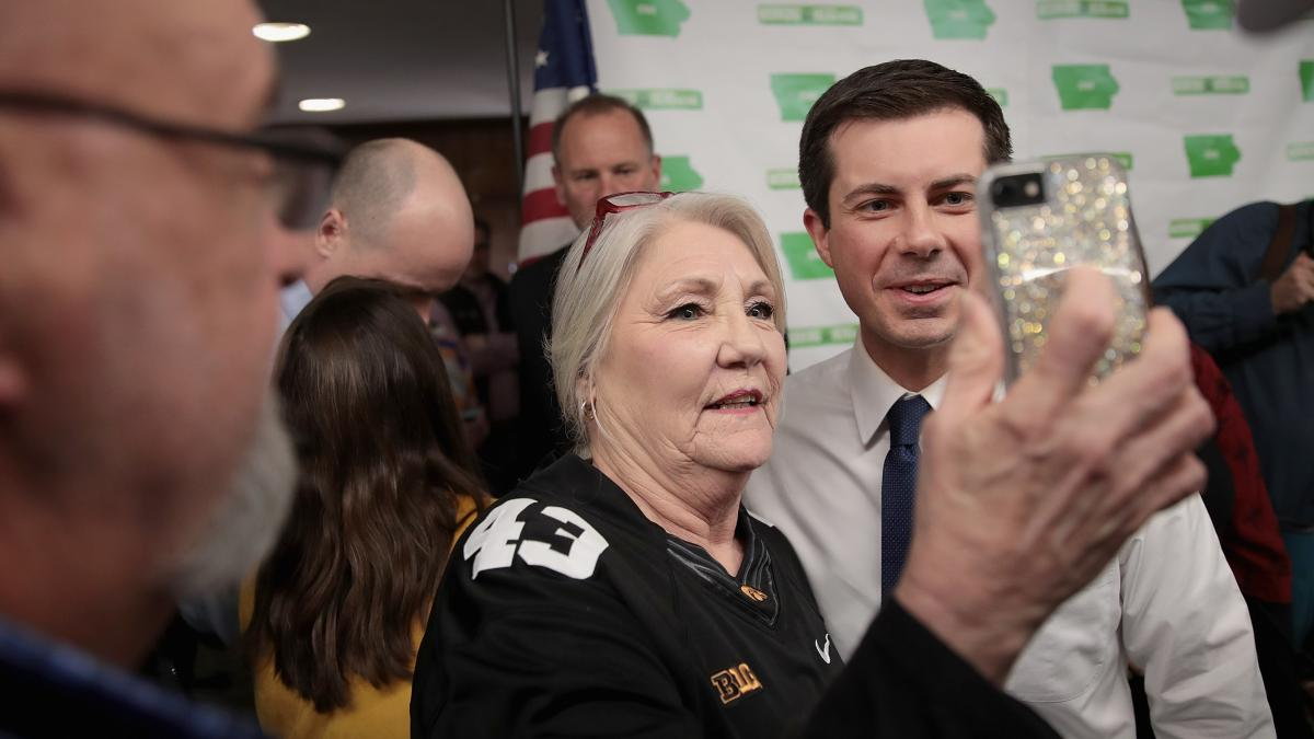 South Bend, Ind., Mayor Pete Buttigieg poses for a picture with a voter following a town hall meeting in Fort Dodge, Iowa, on April 16.