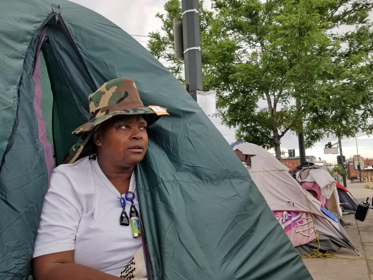 Melody Lewis moved to Denver's streets about six years ago. Last month, Lewis and hundreds of others who are homeless were displaced from sprawling, blocks-long encampments. She moved her tent, but refused to enter a shelter, partly because of the increas