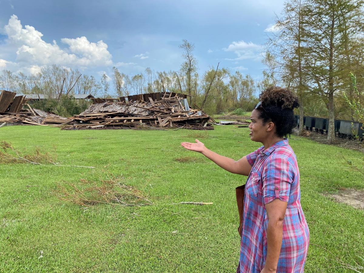 Joy Banner points to the two sharecropper cabins that were flattened by Hurricane Ida's ferocious winds.