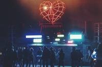 The Robot Heart car illuminates the darkened playa at the 2014 festival.