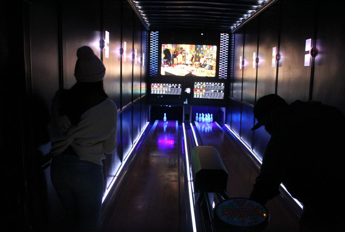 The neon-lit Luxury Strike mobile bowling alley includes two 25-foot lanes, an automatic ball return, automatic pin-resetters and even digital scorekeepers.