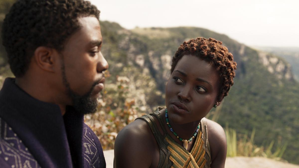 L to R: Chadwick Boseman as T'Challa/Black Panther and Nakia (Lupita Nyong'o) in Black Panther.