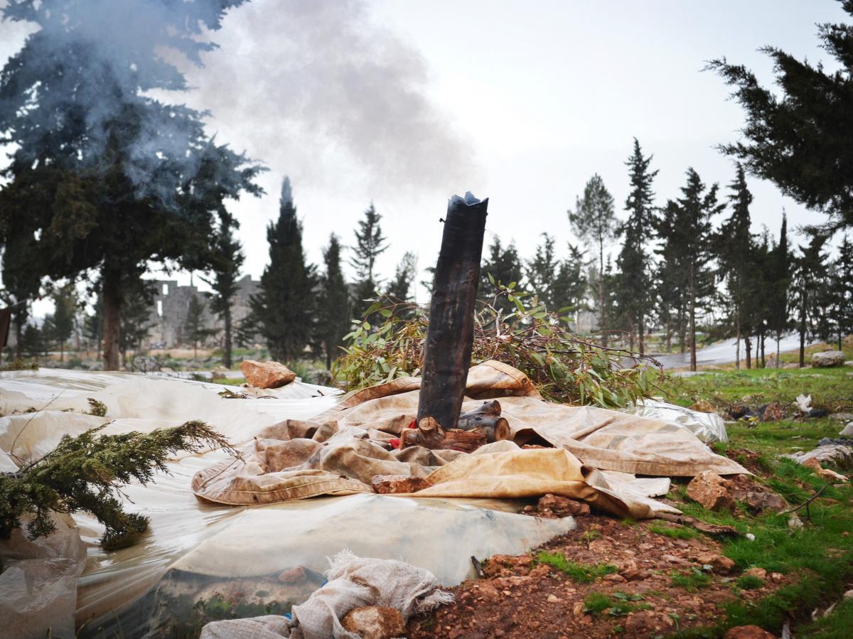 Smokestacks mark the underground dwellings of Syrians fleeing fighting in their hometowns.