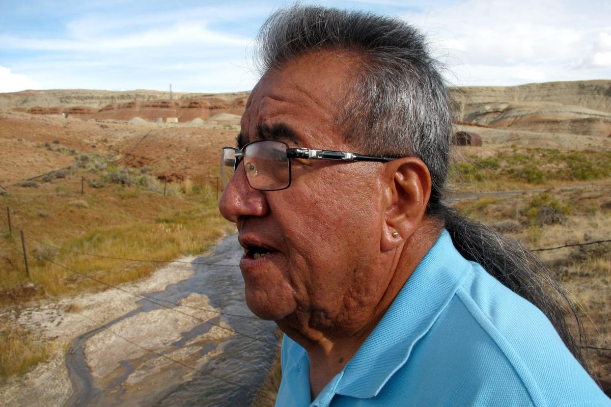 "Wes Martel, vice chairman for the Eastern Shoshone Business Council, stands near a murky gray stream full of oil field wastewater. He's concerned about the effects the wastewater has on wildlife, water quality and, since cows drink it, he wonders: ""What's"
