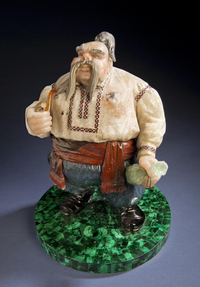 Cossack, completed in 1979, is another classic image, which reflects Konovalenko's Ukrainian heritage. It was completed in 1979. The base of the sculpture is nephrite; the Cossack's shirt is cacholong, a form of opal, and includes enamel inlay. It measure
