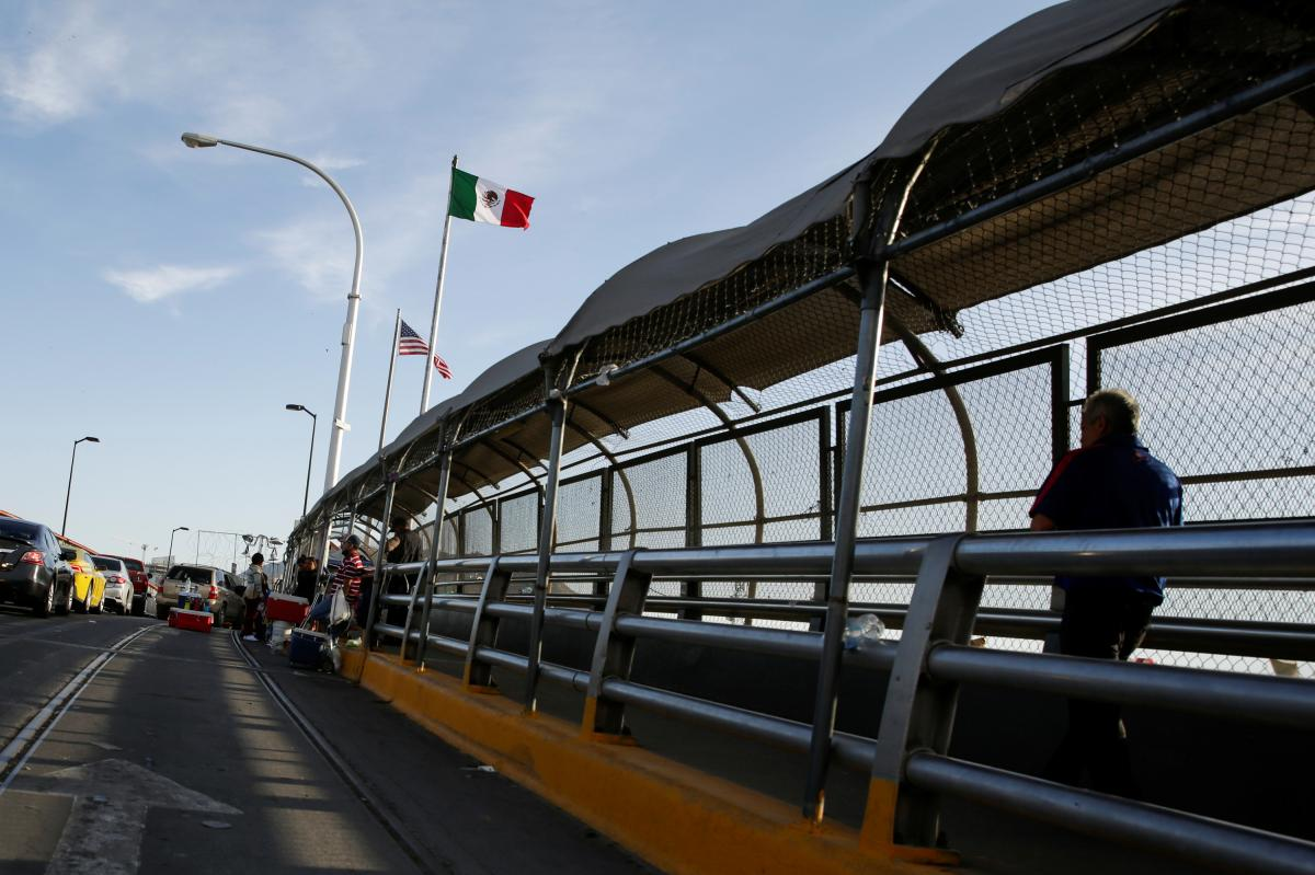 A man crosses the Paso del Norte border bridge toward El Paso, Texas, as seen from Ciudad Juárez, Mexico, on July 1. Since March, U.S. immigration officials have turned away tens of thousands of migrants, including asylum-seekers and unaccompanied childr