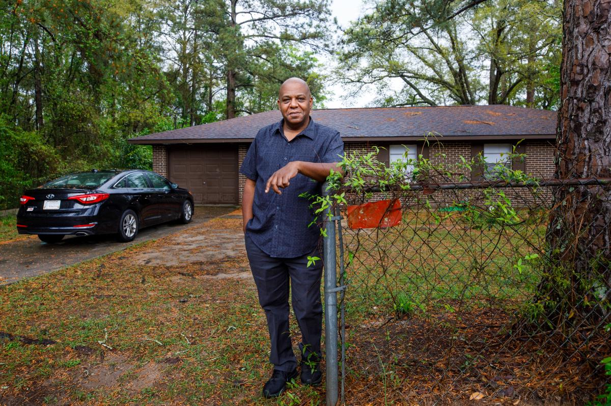 Gregory Curry stands in the front of the house he is now renting after a seven-month stretch of being without a home, Sunday in Dothan, Ala. Last year COVID-19 shut down the furniture store where he worked as a salesman and started his journey through eco