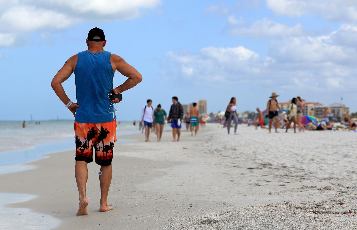 People continued to gather on Florida beaches such as Clearwater Beach after the coronavirus had already started to spread in the U.S. On March 20, the city of Clearwater ordered all its public beaches to close. As of Friday, Florida has more than 2,400 c