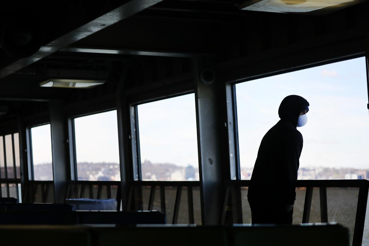 """Tremaine Fredericks rides a nearly empty Staten Island Ferry to Manhattan in New York City. Gov. Andrew Cuomo's """"New York State on PAUSE"""" executive order went into effect on March 22."""