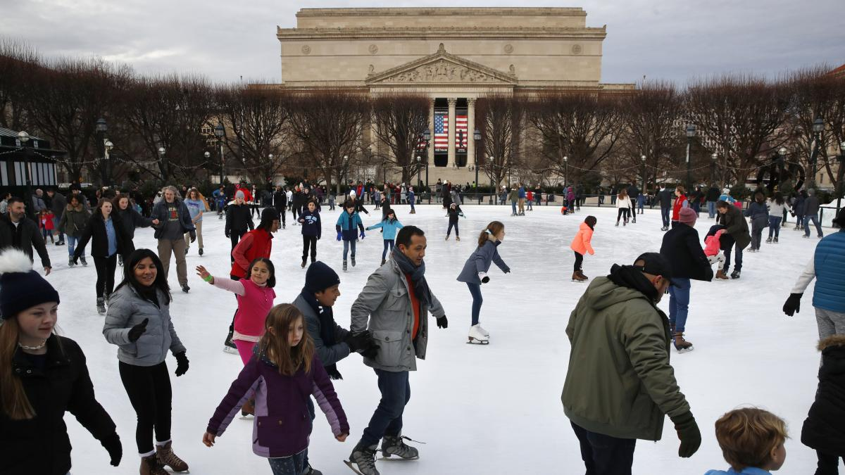 People get in what could be their last skate for a while at the National Gallery of Art Sculpture Garden Ice Rink this week. The museum and the skate rink will be closed to the public after Jan. 2 if the shutdown continues into the new year.