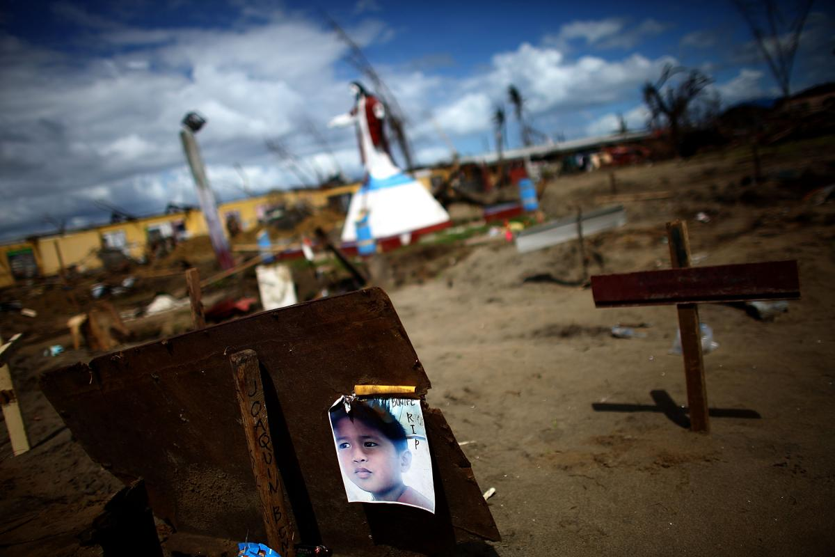 A makeshift headstone in the mass grave outside of San Joaquin Parish in the province of Leyte, Philippines. The Catholic parish has lost almost two-thirds of its congregation after Typhoon Haiyan swept through the area.