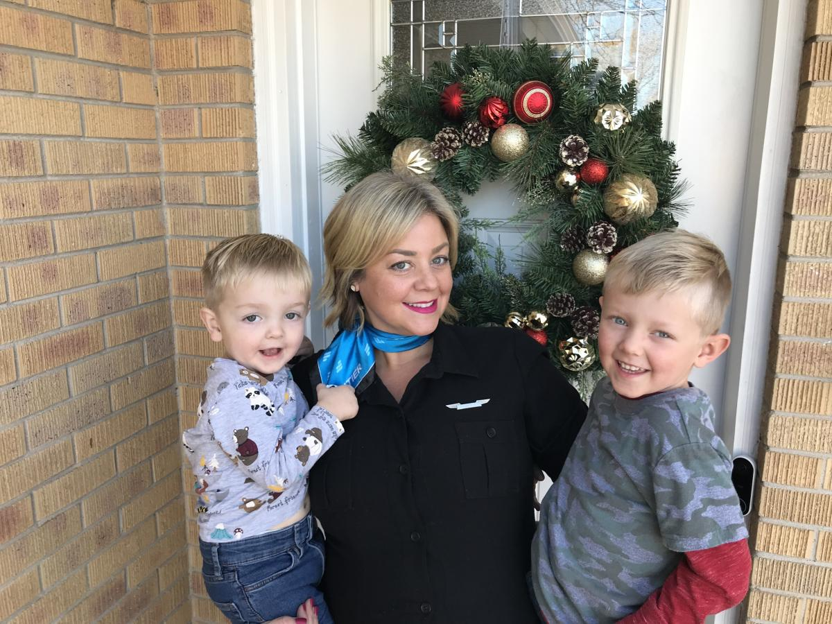 Melissa Hodgkins, a flight attendant who is part of a class-action lawsuit against Frontier Airlines, with her two sons. Hodgkins says the airline's policies forced her to take unpaid leave and led her to stop breastfeeding prematurely.