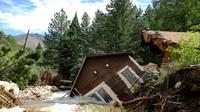 Flooding brought down a house in Jamestown, Colo., on Sept. 18.