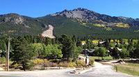 A massive landslide, left, in the Rockies, sent mud, rocks, boulders and trees barreling down the slopes.
